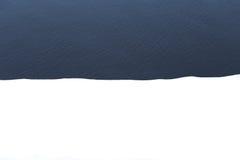 Błękitne wody i śnieg minimalista Zdjęcie Royalty Free