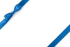 Błękitnego faborku łęku skład odizolowywający na białym tle z cieniem Fotografia Stock