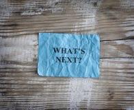 Błękitnego papieru nutowy saying Co jest następny? obraz royalty free