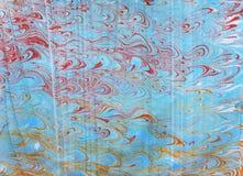 Błękitnej czerwieni ebru z fala wzorem Fotografia Royalty Free