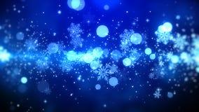 Błękitni bokeh i płatków śniegu światła na błękitnym tle z Bożenarodzeniowym tematem Zdjęcia Royalty Free
