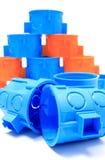 Błękitni i pomarańczowi elektryczni pudełka na białym tle Obrazy Stock