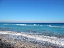 Błękitni loguna plaży otoczaki Fotografia Stock