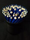 Błękitni ołówki na czarnym tle Zdjęcie Royalty Free