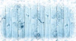 Błękitny Bożenarodzeniowy tło Deski w śniegu panorama Obraz Stock