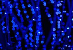 Błękitny defocused błyskotliwości tło z bokeh kopii przestrzenią Obraz Royalty Free