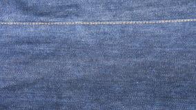 Błękitny drelichowy cajgów płótna tło Zdjęcie Stock