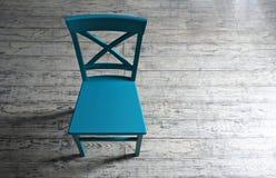 Błękitny drewniany krzesło na drewnianych desek tle Fotografia Royalty Free