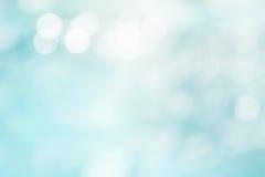 Błękitny falowy tło na bokeh stylu Obrazy Royalty Free