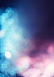 Błękitny fiołkowy bokeh abstrakta światło Obraz Royalty Free