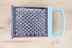 Błękitny grater na drewnie Obrazy Stock