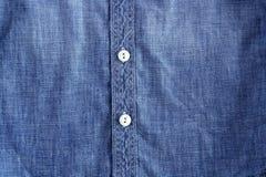 błękitny guzików drelichowych cajgów koszulowa tekstura Fotografia Royalty Free