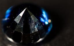 Błękitny klejnot na czarnym tle Zdjęcia Royalty Free