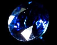 Błękitny klejnot na czarnym tle Fotografia Stock