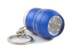 Błękitny metalu DOWODZONY fleszu keychain odizolowywający Fotografia Stock