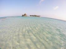Błękitny morze z małą wyspą Fotografia Stock