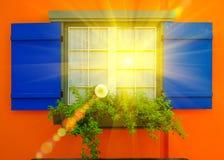 Błękitny okno na kolor żółty ściany tle z oświetlenie racy skutkiem na okno Zdjęcie Stock