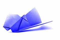 Błękitny origami samolot, papierowy handmade samolot odizolowywający na białym tle Obrazy Stock