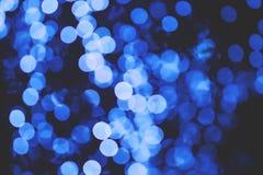 Błękitny plamy bokeh od światła na ciemnej nocy dla tła fotografia royalty free