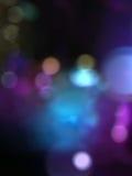 Błękitny purpury plamy bokeh tło Fotografia Royalty Free