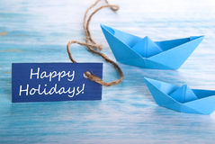 Błękitny sztandar z Szczęśliwymi wakacjami Fotografia Stock