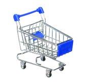 Błękitny wózek na zakupy na bielu Obraz Royalty Free