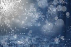 Błękitny wakacyjny abstrakcjonistyczny tło z gwiazdami i płatkami śniegu Obraz Royalty Free