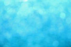 Błękitny zimy bokeh zaświeca abstrakcjonistycznego tło Obrazy Royalty Free
