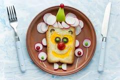 Błazen twarzy kanapka zdjęcia royalty free