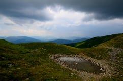 Błotnista kałuża w górach Zdjęcia Stock