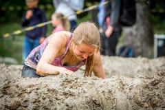 Błotnista kobieta w błoto bieg Fotografia Stock