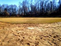 Błotnisty baseballa pole w przyprawiającym daleko Zdjęcie Stock