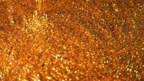 Błyskotliwa błyskotliwość Złoty migoczący bezszwowej pętli ruchu abstrakcjonistyczny tło obrazy royalty free