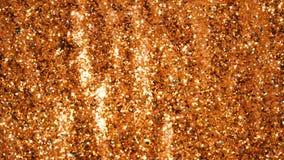 Błyskotliwa błyskotliwość Złoty migoczący bezszwowej pętli ruchu abstrakcjonistyczny tło zdjęcie stock