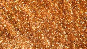Błyskotliwa błyskotliwość Złoty migoczący bezszwowej pętli ruchu abstrakcjonistyczny tło zdjęcia stock