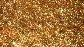 Błyskotliwa błyskotliwość Złoty migoczący bezszwowej pętli ruchu abstrakcjonistyczny tło fotografia royalty free