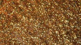 Błyskotliwa błyskotliwość Złoty migoczący bezszwowej pętli ruchu abstrakcjonistyczny tło obrazy stock