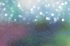 Błyskotliwość rocznik zaświeca tło błękit, zieleń i purpury, defocused zdjęcia stock