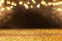 Błyskotliwość rocznik zaświeca tło czarne złoto De skupiający się obraz royalty free