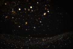 Błyskotliwość rocznik zaświeca tło czarne złoto skupiający się obrazy royalty free
