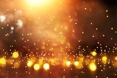 Błyskotliwość rocznik zaświeca tło czarne złoto skupiający się zdjęcie stock