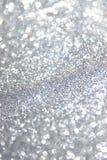 Błyskotliwość rocznik zaświeca tło lekki srebro i czerń defocused obraz stock