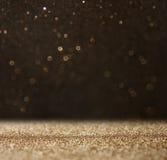 Błyskotliwość rocznik zaświeca tło lekki złoto i czerń defocused zdjęcia royalty free