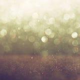 Błyskotliwość rocznik zaświeca tło lekki złoto i czerń defocused zdjęcie stock