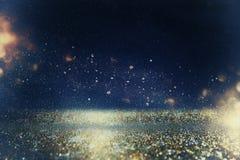 Błyskotliwość Zaświeca Tło złoto, błękit i czerń, obraz stock