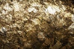 Błyszcząca żółta liść złocistej folii tekstura Zdjęcia Stock
