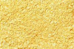 Błyszcząca żółta liść złocistej folii tekstura dla tła Obrazy Royalty Free