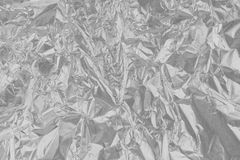 Błyszcząca srebnej folii metalu tekstura, abstrakcjonistyczny szary opakunkowy papier Zdjęcia Stock