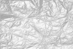 Błyszcząca srebnej folii metalu tekstura, abstrakcjonistyczny szary opakunkowy papier Obrazy Royalty Free
