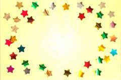 Błyszczące jaskrawe gwiazdy na koloru żółtego barwionym tle fotografia stock